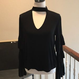 Black shirt with tiered bell sleeves.